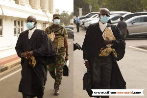 An earlier picture had a military officer carrying the bag of the President's lawyer