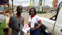 Airtel Premier customer (L) with his souvenirs