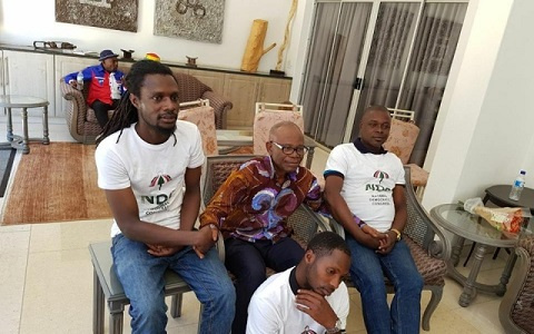 Ayisi-Boateng  in a picture with three men wearing NDC T-shirts