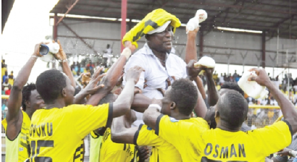 Coach and players of Ashgold jubilating