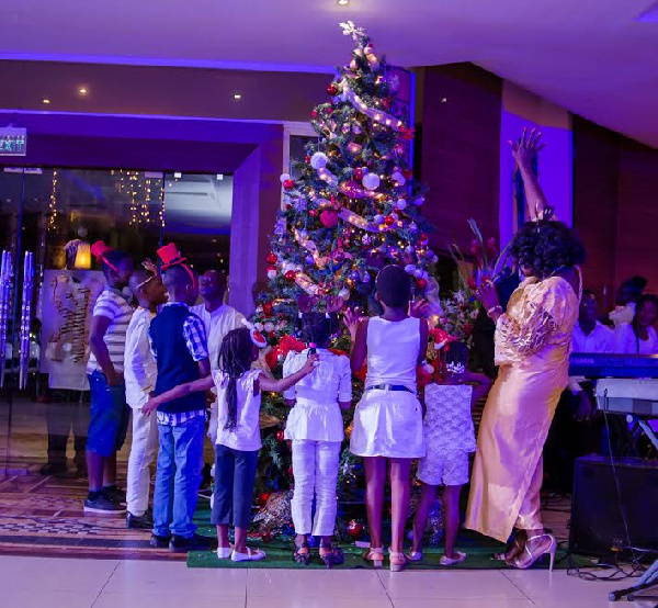 The event was climaxed by splendid performances by six children who lit the Christmas tree