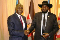 Ambassador Simon Michael Duku (left) and South Sudanese President Salva Kiir (right) in hand shake