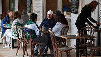 Diners sit at a cafe in Sydney, Australia on October 11 as the city emerges from lockdown