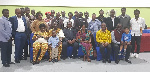 H. E. Dr Joseph Agoe, sitting in the middle, flanked by others