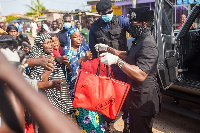 Nana Kwame Bediako handing out goodies to some of the beneficiaries