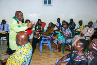 Dan Abodakpi explaining issues to the delegates at the meeting at Anyaa-Sowutuom