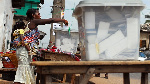 File: A woman casting her vote during a poll