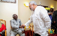 Former President Jerry John Rawlings in a handshake with Former President John Agyekum Kufuor