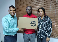 Human Rights Reporters Ghana receiving a brand new HP Laptop Computer