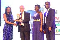 Officials of Avnash Industries Ghana receiving the award