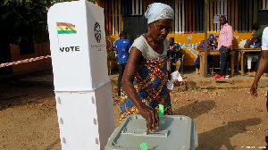 An Old Woman Casting Her Ballot In A Previous Election