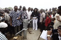 Yvonne Okoro pumping the commissioned bore hole
