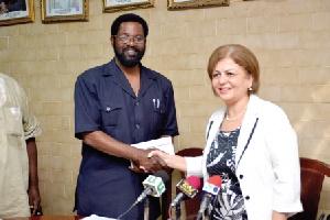 Alfred Okoe Vanderpuye, receiving the cheque from Ms. Nesrin Bayazit, Ambassador of Turkey to Ghana.