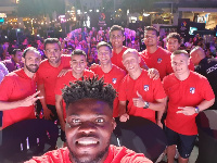 Thomas Partey leads Atletico players to take an imposing selfie in Singapore with fans at the back