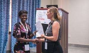 Charllote Abena Benyarku receiving her certificate