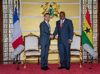 French Prime Minister, Manuel Carlos Valls Galfetti in a handshake with President Mahama
