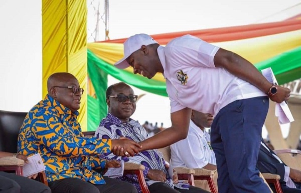 Dr Ibrahim Anyars in a handshake with President Akufo-Addo