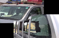 The damaged windscreen of the Police vehicles