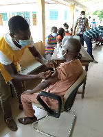 Thomas Moore Zonyrah, District Chief Executive (DCE) for Central Tongu taking his jab