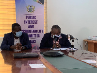 The Public Interest and Accountability Committee reading its report on petroleum revenue