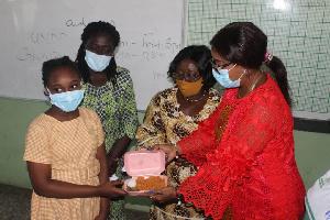 Mrs Akosua Frema Opare and Cynthia Morrison serving JHS candidates with Jollof rice