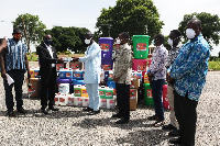 Mr Saeed (in white) receiving the items from Mr Gmabi