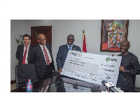 Ken Ofori-Atta receiving the cheque from Mr. Darko during the presentation of dividend to government