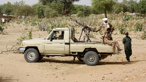 A convoy of Sudanese security forces deploy during a rally in al-Geneina, PHOTO | AFP