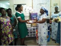 Mrs Rebecca Nkansah Kyeremateng (right) presenting the gifts to Mrs Elizabeth Ogoe Annan (left)