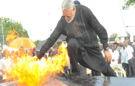 Rawlings dips hand into blazing fire