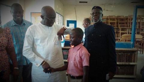 Joseph Kofi Adda with the 12-year-old boy