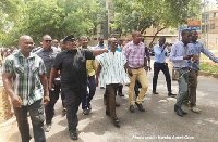 Koku Anyidoho clad in black and prancing on the streets as he headed to the Police CID headquarters