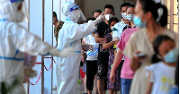 Residents queue to undergo nucleic acid tests for coronavirus in Xianyou county