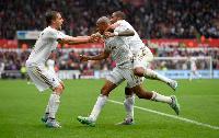 Andre Ayew celebrates for Swansea City