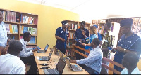 COP Ampah Bennin and Mr Tetteh Padi (seated 2nd right) at the Egyei-krom Refugee library