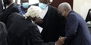 Mahama and his lawyers in court