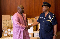 Dr Bampoe shakes DCOP Ampah Benin Director General Public Affairs of the Ghana Police Service
