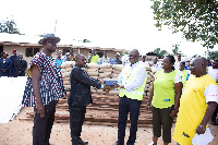 Vivo Energy Ghana MD, Ben Hassan Ouattara [R] presenting building materials
