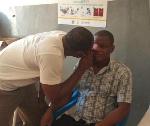 Desmond Yaani examining a client