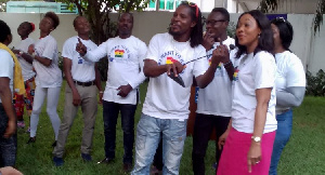 Mrs. Mensah, Borax and others performing to Mr. Politician song at the IEA Garden.