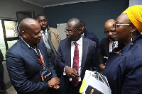 Dr. Agyepong (middle) interacts with colleagues
