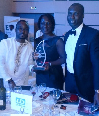 The uniBank delegation displaying the award