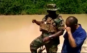 The soldier giving the Chinese illegal miner a talkdown