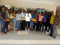 Game Boy in a group picture with staff of Gaming Commission of Ghana