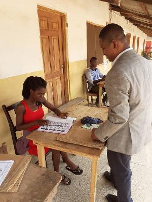 Mohammed Adamu Ramadan checking his name at a polling station
