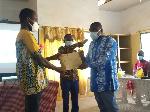 Bin-Eranaa Jerdu Nuhu, Ag. District Health Director for Lambussie District in blue