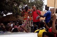 Mr Dominic Adoboe addressing a crowd in the Bator market