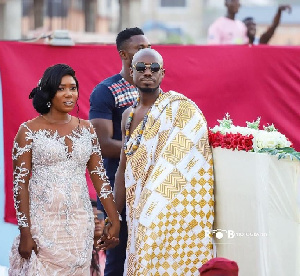 Eugene Osafo-Nkansah with his wife during their wedding