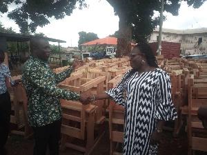 MCE for Lower Manya Krobo, Simon Tetteh presenting the furniture to Mrs Agnes Akweley Attipoe