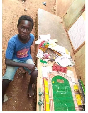Desmond Amonuu by his architectural model of Axim Sports Complex